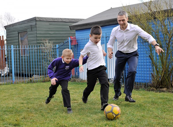 Matt Beeton practising his football skills with some of children from the Connected Kids Club