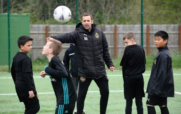 South Shields FC Player and Foundation Coach, Blair Adams directs children at the club's Let's Play Thursday session.