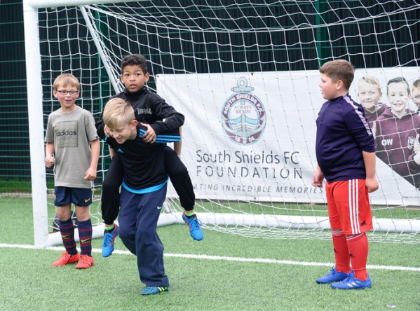 Local children getting involved in the game at South Shields FC